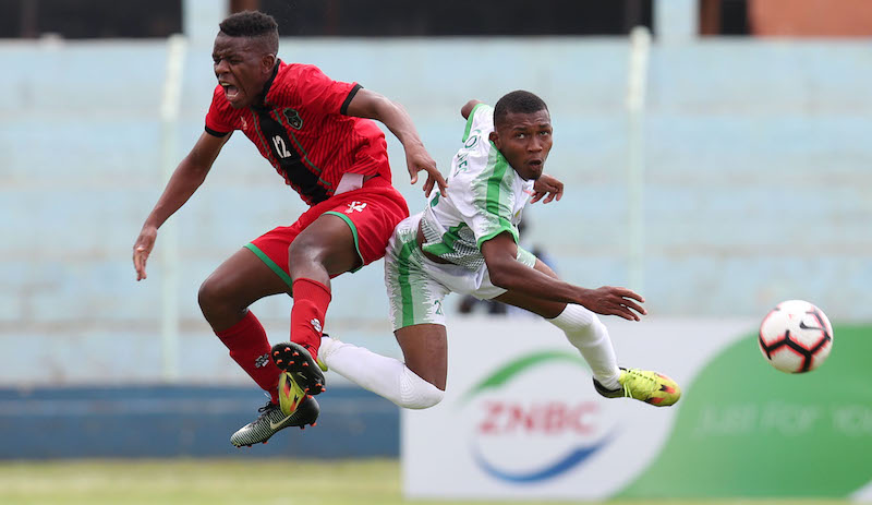 Henry Chiwaya of Malawi challenged by Silahi Madi Riad of Comoros during the 2019 COSAFA U20 match between Comoros and Malawi at the Nkoloma Stadium, Lusaka on the 04 December 2019 ©Muzi Ntombela/BackpagePix