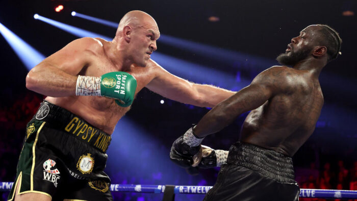 LAS VEGAS, NEVADA - FEBRUARY 22: Tyson Fury (L) punches Deontay Wilder during their Heavyweight bout for Wilder's WBC and Fury's lineal heavyweight title on February 22, 2020 at MGM Grand Garden Arena in Las Vegas, Nevada.   Al Bello/Getty Images/AFP