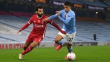 Mohamed Salah, à la lutte ici avec Joao Cancelo, portera encore l'attaque de Liverpool