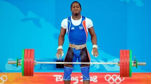 Vencelas Dabaya-Tientcheu of France fails a lift in the men's 69 kg weightlifting event during the 2008 Beijing Olympic Games at the Beijing University of Aeronautics and Astronautics Gymnasium in Beijing on August 12, 2008. Liao Hui of China won the men's 69kg weightlifting gold medal while Dabaya-Tientcheu  took silver and Tigran Martirosyan of Armenia claimed bronze.AFP PHOTO/JUNG YEON-JE