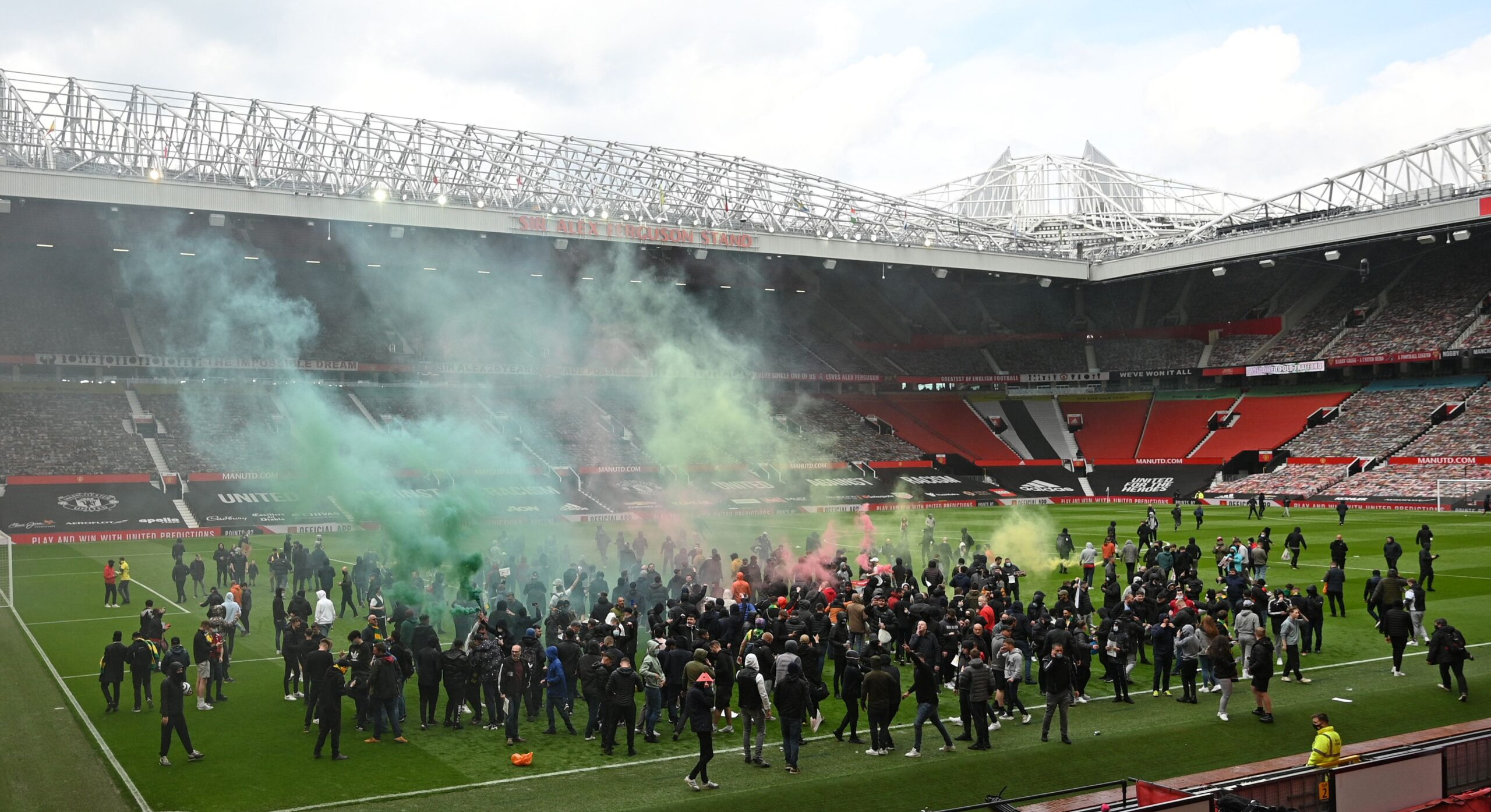 Supporters protest against Manchester United's owners, inside English Premier League club Manchester United's Old Trafford stadium in Manchester, north west England on May 2, 2021, ahead of their English Premier League fixture against Liverpool. - Manchester United were one of six Premier League teams to sign up to the breakaway European Super League tournament. But just 48 hours later the Super League collapsed as United and the rest of the English clubs pulled out. (Photo by Oli SCARFF / AFP)