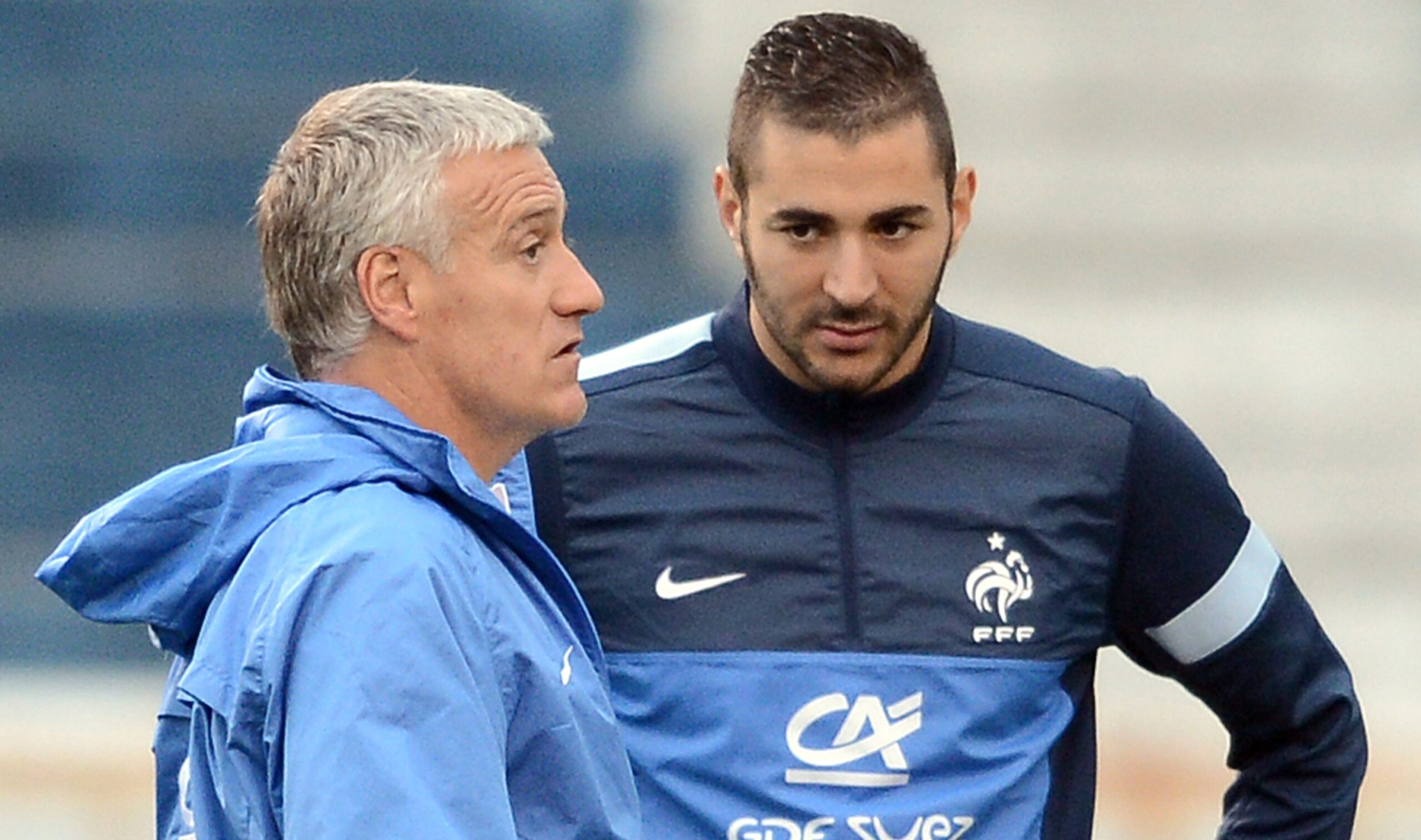 French national football team's head coach Didier Deschamps (L) speaks with next to forward Karim Benzema (C) during a training session at the Gremio Stadium in Porto Alegre, Brazil on June 6, 2013 .  AFP PHOTO / FRANCK FIFE / AFP / FRANCK FIFE        (Photo credit should read FRANCK FIFE/AFP/Getty Images)