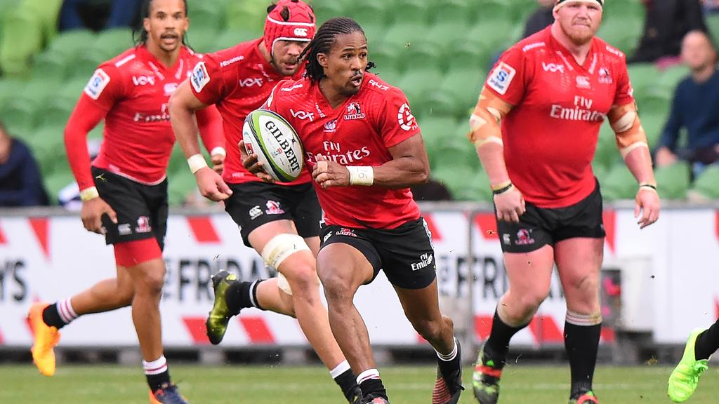 Lions' Sylvian Mahuza (C) runs with the ball during the Super Rugby match between the Melbourne Rebels and Golden Lions at AAMI Park in Melbourne on May 6, 2017. / AFP PHOTO / Mal Fairclough / -- IMAGE RESTRICTED TO EDITORIAL USE - STRICTLY NO COMMERCIAL USE --