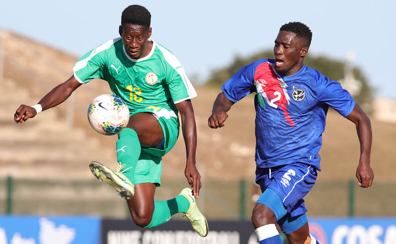 Abou Bakry Diop of Senegal challenged by Denzil Haoseb of Namibia during the 2021 COSAFA Cup match between Senegal and Namibia at Nelson Isaac Wolfson Stadium, Port Elizabeth, on 07 July 2021 ©Samuel Shivambu/BackpagePix